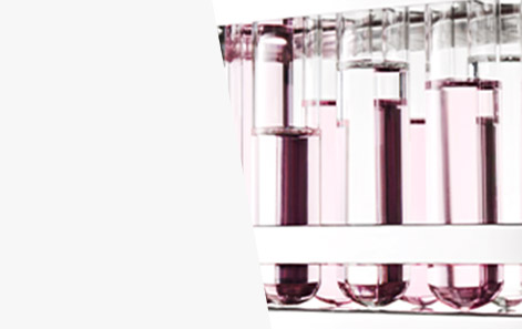 Beakers filled with light pink liquid are shown to represent Mary Kay's research and development in cosmetics.